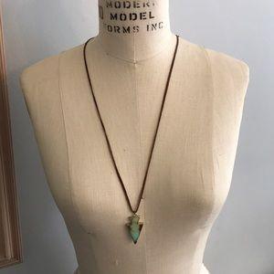 Arrowhead on leather necklace.